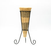 Vases are made of wicker, placed on a wrought iron base, hand made, cone shaped isolated Stock Image