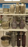 Vases on the shelf. Silver and golden vase for sale stock photo
