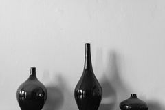 A painting of glass jar. Photo in black and white of three glass vases and white background stock photos