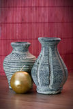 Vases of terracotta and yellow candle Royalty Free Stock Photography