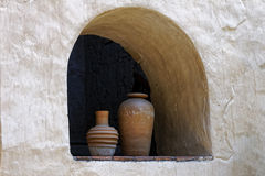 Two terracotta vases in an alcove set in to a whitewashed wall Stock Photography