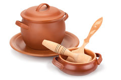 Vasi di argilla, utensili di legno e un piatto di Immagini Stock