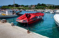 VASILIKOS, ZAKYNTHOS ISLAND, GREECE, JUNE 02, 2016: Red speed boat Dake Devil jet for tourists. Agressive design boat. Greece isla stock images