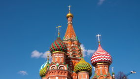 Vasily Blazhennogo's cathedral. On a background of the blue sky stock footage