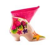 Vaso com o guardanapo cor-de-rosa isolado no fundo branco Foto de Stock