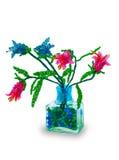 Vaso con i fiori dai branelli di vetro immagini stock libere da diritti