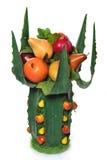 Vaso dei fogli dell'aloe con la frutta. Fotografia Stock