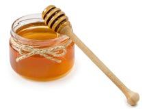 Vaso del miele su fondo bianco isolato Fotografia Stock