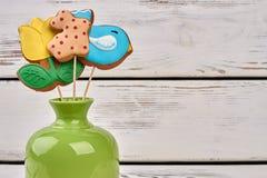 Vaso e biscoitos geados da Páscoa Imagens de Stock