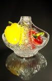 Vaso e pimentas de cristal Fotos de Stock