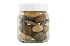Vaso trasparente con differenti pietre Fotografia Stock Libera da Diritti