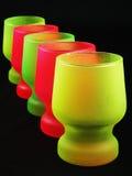 Vasos de medida coloridos fotografía de archivo