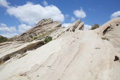 Vasquez Rocks IV. These sheer rocks grow into the sky like nature`s skycrapers. Millions years ago earth was moving and built these rocks Royalty Free Stock Photo