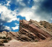 Vasquez Rocks before the storm. Vasquez Rocks against stormy blue sky stock images