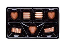 Vassoio di plastica con il cioccolato del lusso del latte dolce Immagini Stock Libere da Diritti
