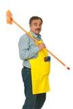Vassoura carreg do homem sênior da limpeza Fotografia de Stock Royalty Free