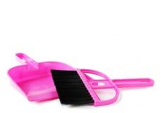 Vassoura e pá-de-lixo cor-de-rosa Foto de Stock Royalty Free