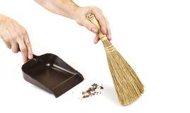 Vassoura pequena da mão para a limpeza do agregado familiar no branco fotografia de stock royalty free