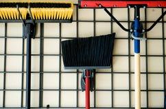 Vassouras e outras ferramentas Fotografia de Stock Royalty Free