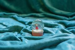 Vast area covered with blanket drapes. Snowglobe in the center. Stock Photo