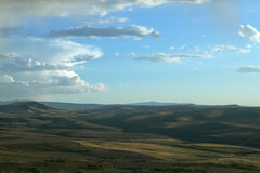 Vast, arid American landscape and distant hills. A panoramic view of an American arid landscape with distant, rolling hills in southwest Wyoming Royalty Free Stock Images