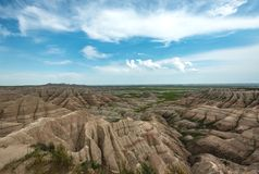Vast Badlands. Rock Formations on Partly Sunny Day royalty free stock photography