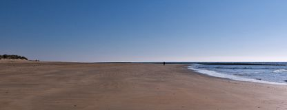 Vast beach in Andalusia near the Guadalquivir. The sky is blu with without clouds and with low tide. royalty free stock image