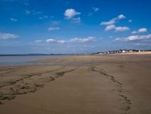Vast beach in Normandie near an holiday`s village. stock image