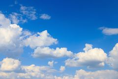 The vast blue sky. And clouds sky stock image