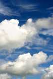 Vast blue sky with clouds Stock Photos