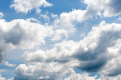 The vast blue sky and clouds sky. Storm clouds on the horizon. Stock Image