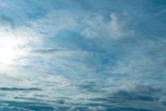 The vast blue sky and clouds sky. clouds in the sky. Sun rays through the clouds royalty free stock image