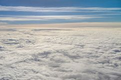 Vast cloudscape. Vast sunny cloud landscape from above in the blue sky royalty free stock photos