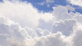 The vast cumulus clouds and  blue sky. Royalty Free Stock Photography