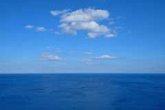 Vast deep blue sea with clouds Stock Photography