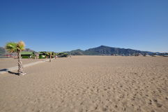 Vast empty beach. Empty, vacant, vast sandy beach in Dalyan, Turkey stock images