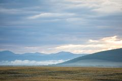 Vast foggy landscape in the northern Mongolia. Vast foggy autumn landscape in the northern Mongolia. Khuvsgol, Mongolia Royalty Free Stock Photos