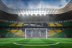 Vast football stadium with goal Royalty Free Stock Image