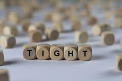 Vast - kubus met brieven, teken met houten kubussen stock afbeelding