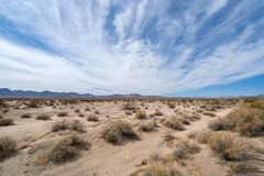 Mohave Desert landscape with blue cloudy skies stock photo