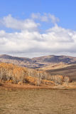Vast Mongolian steppe with a blue cloudy sky, Mulan Weichang, China Royalty Free Stock Photos