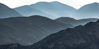 Vast mountain ridge in Ontario California in haze. Vast mountain ridge in Ontario California. View of the vast mountain ridge in Ontario, California beneath a stock photography