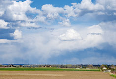Vast Open Farm Field with Dramatic Clouds Royalty Free Stock Images