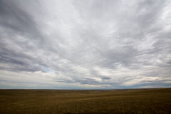 Vast open plains of North Dakota, America. Landscape view under a dramatic grey cloudy sky of the vast open plains and prairies of North Dakota, America stock images