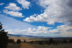 Vast open valley under sky and clouds Royalty Free Stock Images