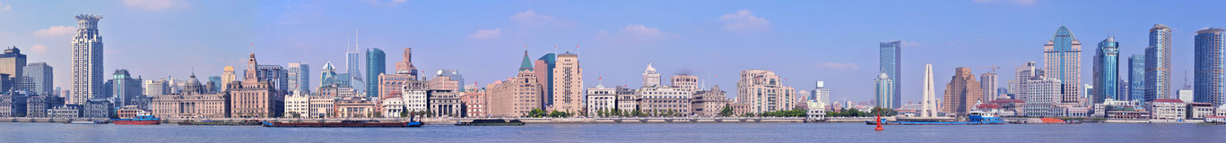 Vast panorama of Shanghai Bund. Vast panorama view of Shanghai Bund in day light under blue sky, with historical and modern city building, as one of the most stock photography