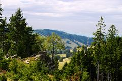 Vast panorama view from the forested hill in the Owl Mountains Landscape Park, Sudetes, Poland. Royalty Free Stock Images