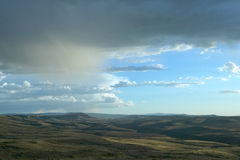 Vast, panoramic arid landscape and moody sky Royalty Free Stock Images