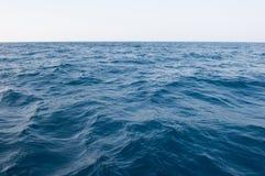 The vast sea. And Blue sky stock photos