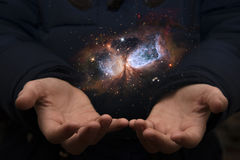 The vast universe in the hands of a child. Elements of this imag Stock Image